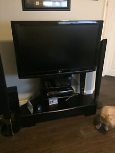 47 inch LG tv and surround sound with stand