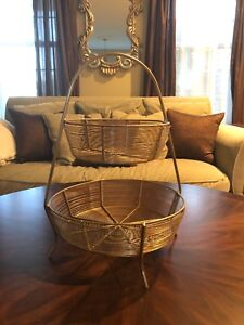Two tiered gold basket stand