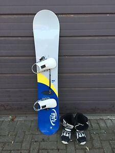 Barely Used Snowboard and Size 9 boots