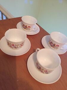 Set of fine porcelain cups and saucers-made in France.