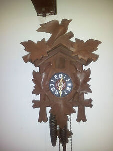 Vintage Cuckoo clock made in Germany  Timber case all complete