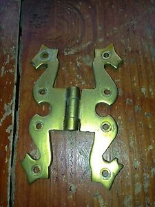 ornate early 1900s brass hinge