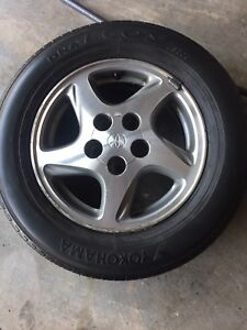 15 Inch Toyota Rims with summer tires.