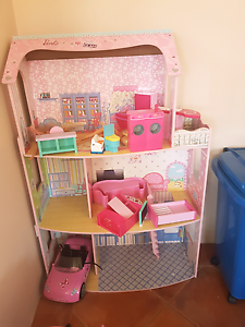 wooden barbie house with dolls and 2 cars Port Kennedy Rockingham Area Preview