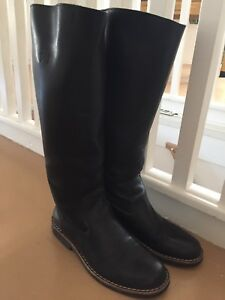 Women's leather Roots boots.