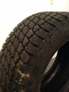 """2-38"""" tires and a 6.5' tounel cover for 1/2 ton"""
