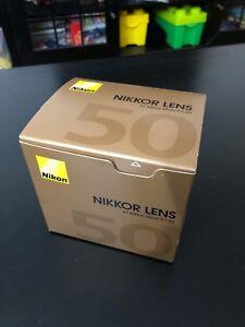 Very clean lens AF Nikkor 50mm f/1.4D $300