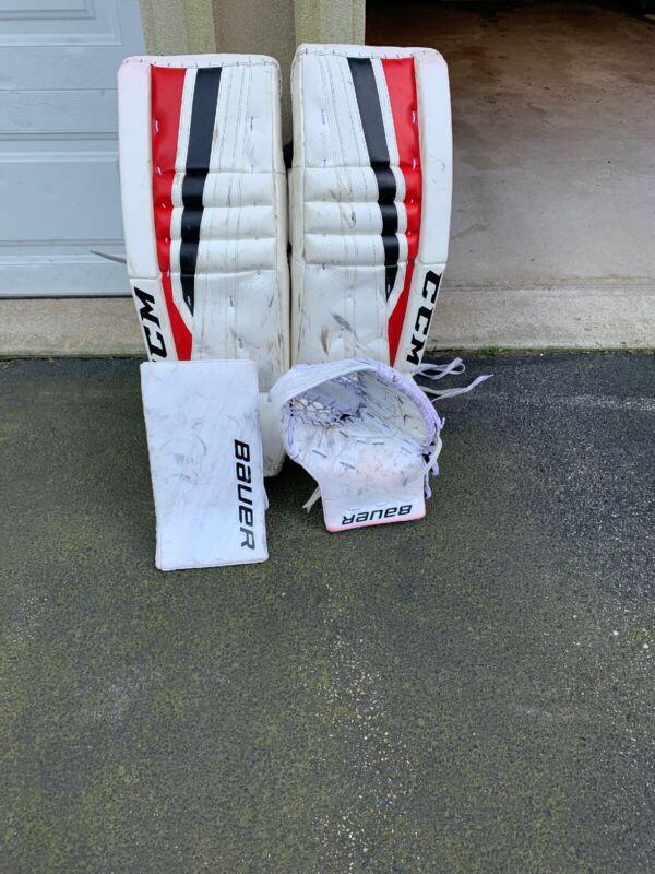 Ccm/Bauer Ice Hockey Goalie Pads, Blocker And Trapper Set.