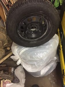 4 good year studded winter tires and rims