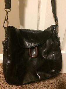 Black handbag with long adjustable strap