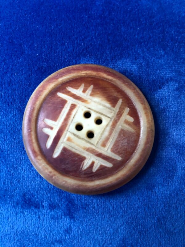 "Old horn button. Carved, four-hole. 1 9/16"" round."