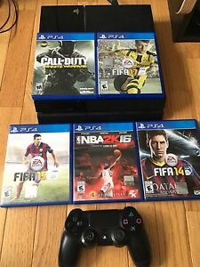 Sony PlayStation 4 with games and a controller