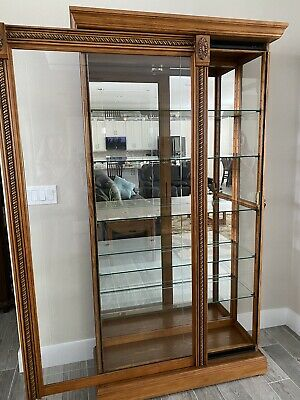 Pulaski Oak Lighted Curio Cabinet Sliding Front Door 5 Adjustable Shelves Front Curio Cabinet