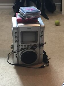 Karaoke machine with microphone and karaoke CDs
