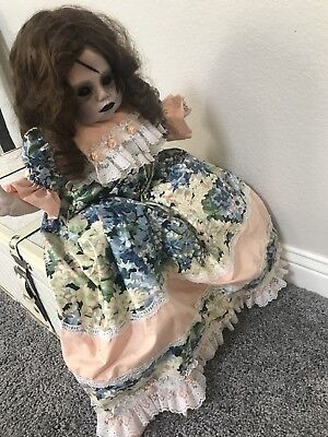 Vintage Doll With A Vintage Dress Look Perfect For Halloween Decoration.