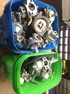 2 buckets of small engine carbs. From chainsaw to 13 horse carbs