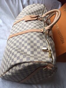 3ad593dccb06 Authentic Louis Vuitton Keepall 55