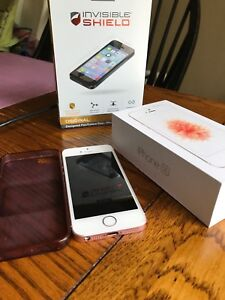 32GB iPhone 6SE with rubber case and screen protector