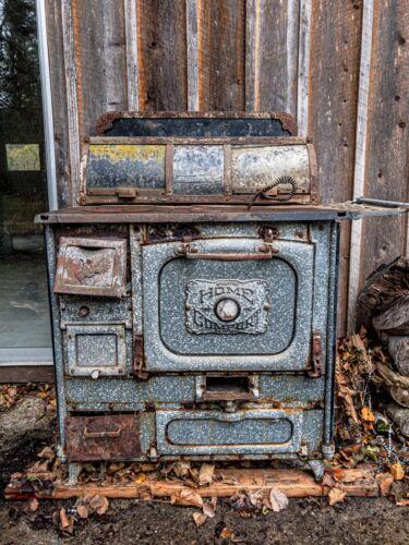 Wrought Iron Range Company Home Comfort No. A1 wood burning stove