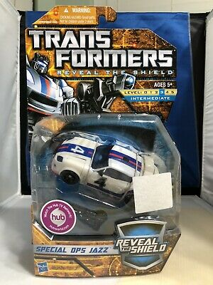 *NIB* Transformers Reveal The Shield Special Ops Jazz Deluxe Class *NIB*