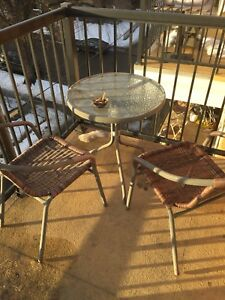 Patio set with glass table