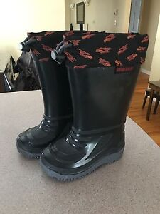 Size 5 lined rubber boots never worn.