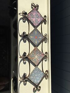 Decorative metal wall piece with four hooks