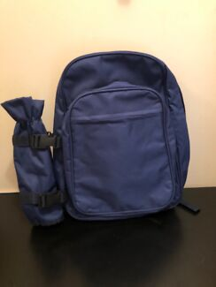 Backpack with detachable insulated water bottle holder