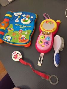 Baby book, toy phone, hair brush and soother holder