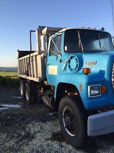 2 L8000 Dump Trucks