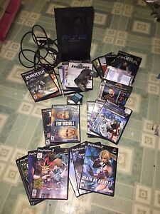 PS2 plus 24 games and memory cards