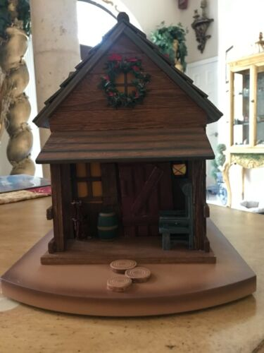 HTF Wood Cabin Advent Calendar with 24 animal figures / ornaments. rotating base