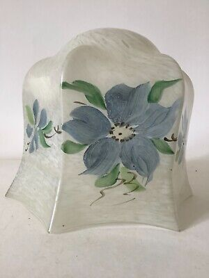 Vintage, glass lamp shade, with a mottled white and blue flower design.