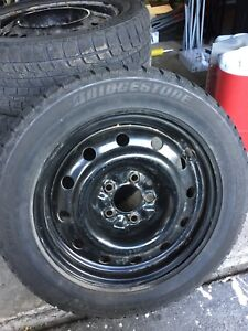$35 Bridgestone Winter tire and rim for nissan