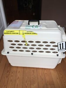 Airline approvedAnimal carrier and dishes