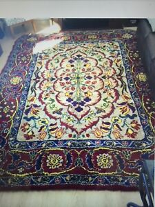 Antique Persian handmade Kilim rug 88 inches by 121 inches.