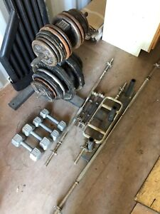Weights, weight rack & bars - Sold pending pick up.