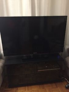 Black Samsung TV with stand