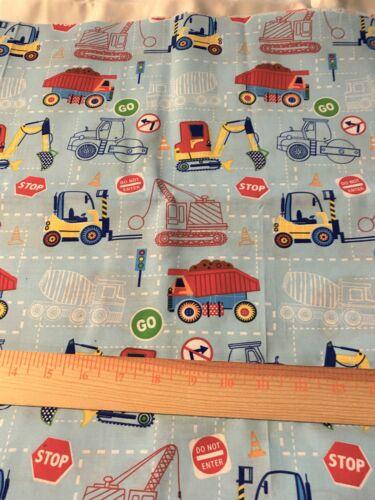 "Novelty cotton fabric construction equipment & signs  on light blue 36"" x 44"""