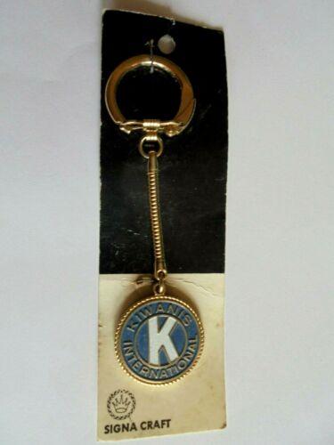 Vintage Kiwanis International Organization Keychain on the Original Card