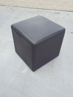 Three dark brown PU leather look cube ottomans