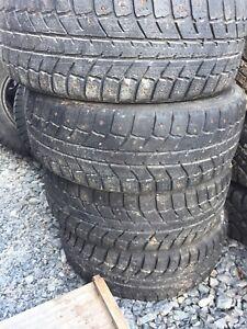 Four studded winter tires 205/55r16 on Subaru 5 bolt rims