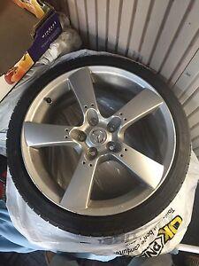"4 18"" Mazda Wheels On 215/40R18 Falken ZE950 Tires"