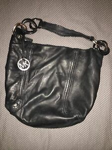 Black Leather purse by Micheal Kors