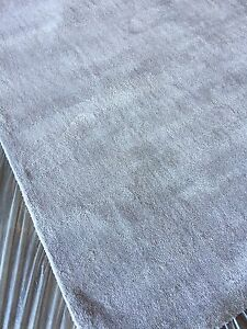 New handwoven short grey area rug