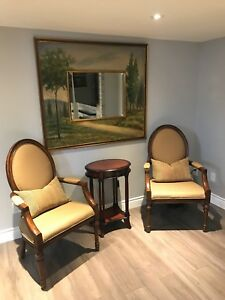 Two chairs, mirror with picture frame, and side table