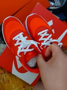 Kids red/orange nike shoes