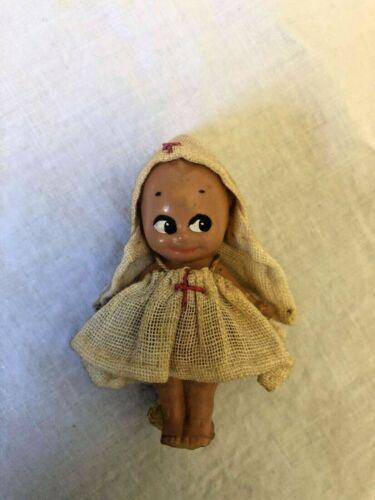 Authentic Kewpie baby, frozen, celluloid, nurse, marked Rose O