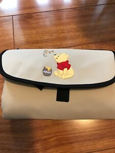 Brand new diaper holder and change pad