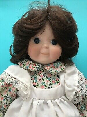 Porcelain Doll with brown curls and flower dress